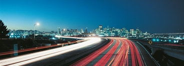 Highway in the evening with long time image exposure. View of San Francisco in the background.
